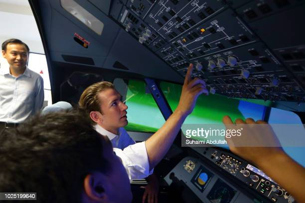 Austrian Chancellor Sebastian Kurz takes part in the Airbus 320 flight simulator and maintenance trainer at Singapore Polytechnic on August 30 2018...