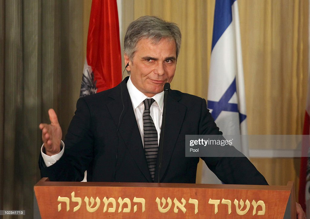 Austrian Chancellor Werner Faymann gestures as he speaks during a joint statement to the press with Israeli Prime Minister Benjamin Netanyahu at Netanyahu's residence June 23, 2010 in Jerusalem, Israel. Faymann is the first foreign leader to meet with Prime Minister Benjamin Netanyahu since the Gaza flotilla raid in May.