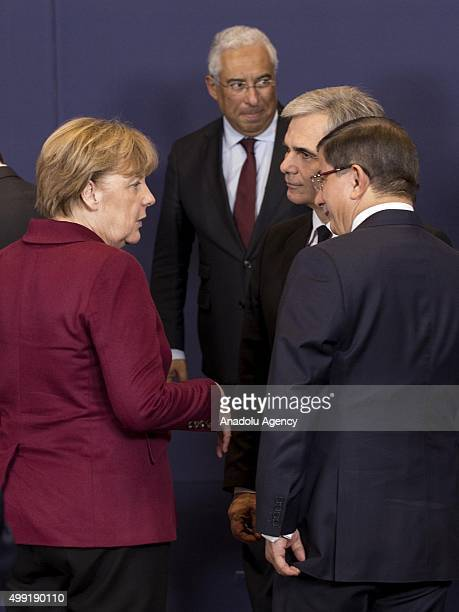 Austrian Chancellor Werner Faymann Turkish Prime Minister Ahmet Davutoglu and German Chancellor Angela Merkel talk at the start of an EUTurkey Summit...