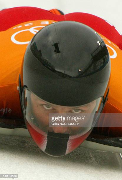 Austrian Christian Auer speeds through the ice channel during a men's skeleton training during the Salt Lake 2002 Olympic Winter Games at the Utah...