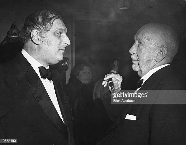 Austrian conductor Clemens Krauss , left, in conversation in London with the German born composer, Richard Strauss .