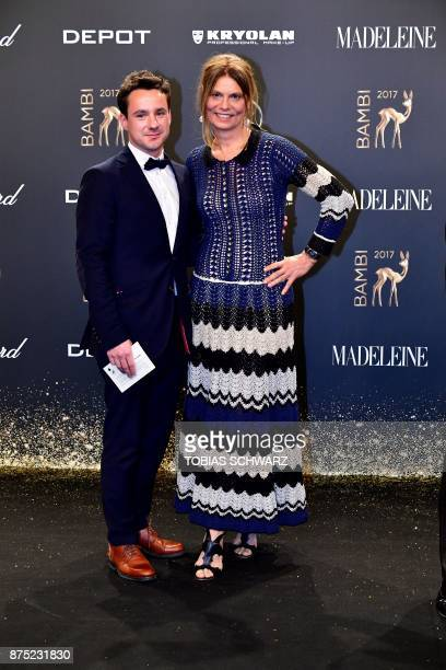 Austrian cook Sarah Wiener and a guest pose on the red carpet upon their arrival for the 2017 BAMBI awards ceremony on November 16 2017 at the Stage...