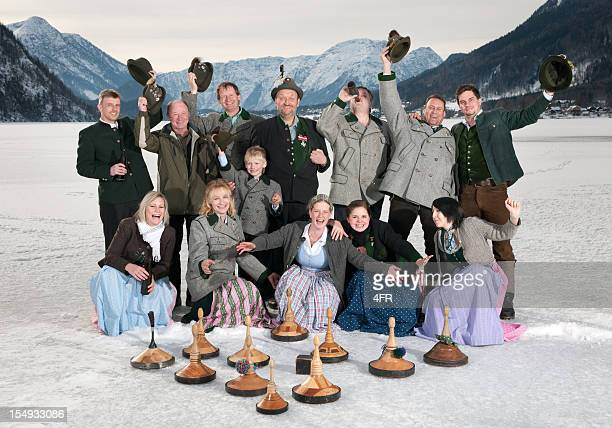 austrian curling team in tracht on the lake grundlsee (xxxl) - traditionally austrian stock pictures, royalty-free photos & images