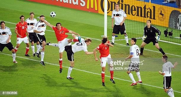 Austrian defender Martin Stranzl vies with German defender Per Mertesacker infront of German goalkeeper Jens Lehmann during the Euro 2008...