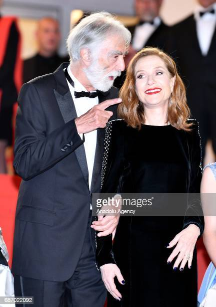 Austrian director Michael Haneke and French actress Isabelle Huppert arrive for the premiere of the film 'Happy End' in competition at the 70th...