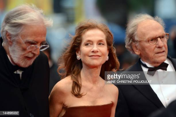 Austrian director Michael Haneke French actress Isabelle Huppert and French actor JeanLouis Trintignant arrive for the screening of 'Amour' presented...