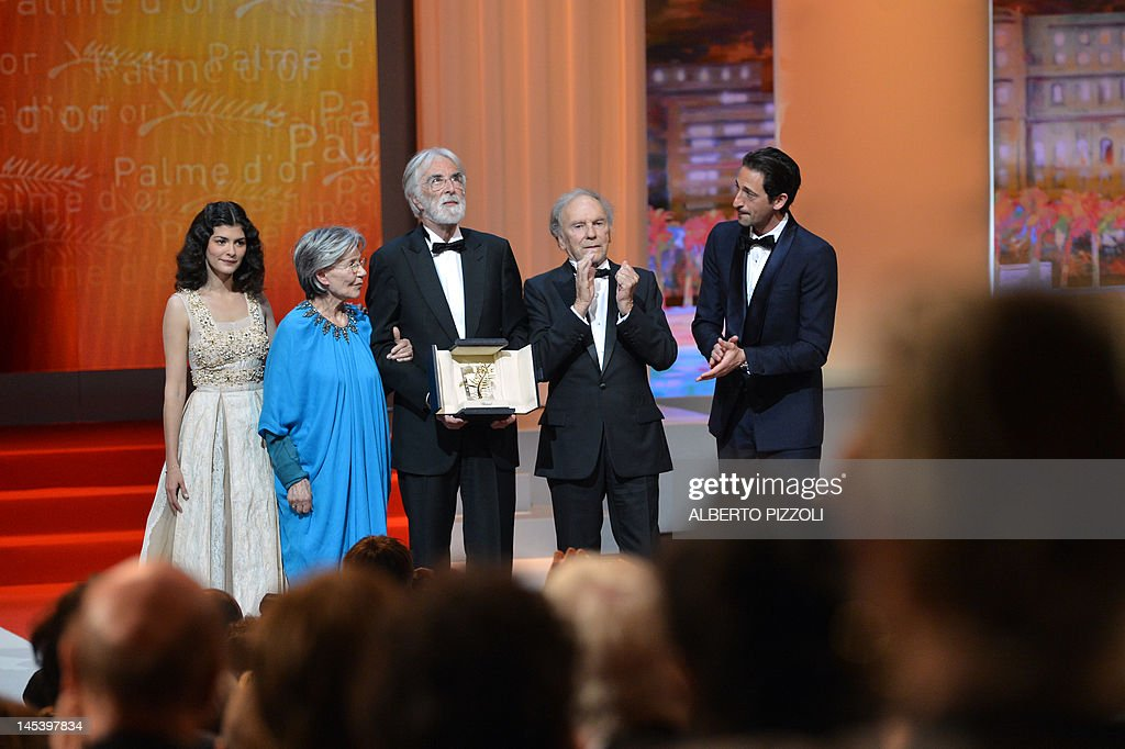 Austrian director Michael Haneke (C) poses on stage with his Palme d'Or flanked by French actresses Audrey Tautou (L), Emmanuelle Riva (2ndL), French actor Jean-Louis Trintignant (2ndR) and US actor Adrien Brody during the closing ceremony of the 65th Cannes film festival on May 27, 2012 in Cannes.