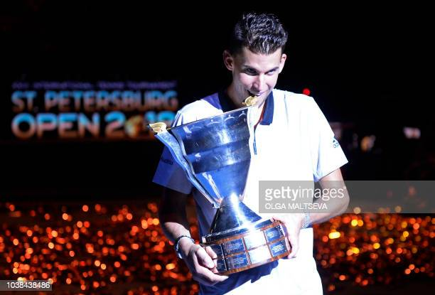 Austrian Dominic Thiem poses with the trophy after winning the Saint Petersburg ATP Open final tennis match on September 23 2018 in Saint Petersburg