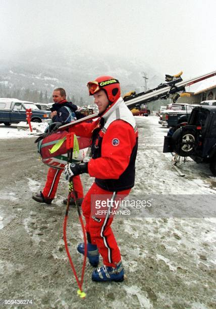 Austrian downhill skier Hermann Maier walks to the parking lot after the race was postponed 05 December for the running of the men's first downhill...