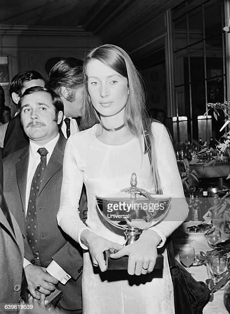 Austrian driver Jochen Rindt's widow Nina with the 1970 Formula One World Champion's trophy won posthumously by her husband