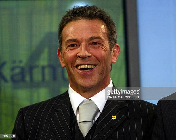 Austrian farright nationalist Joerg Haider appears at his party headquarters in Klagenfurt after the Freedom Party won the provincial parliament...