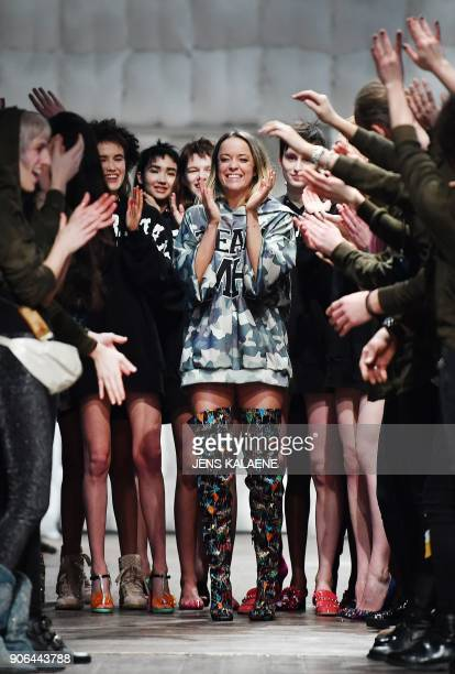 Austrian fashion designer Marina Hoermanseder is applauded by models after a fashion show of the label 'Marina Hoermanseder' during the Fashion Week...