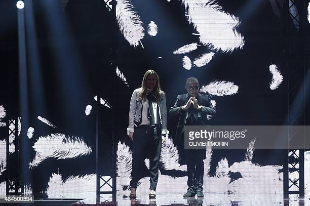 Austrian fashion designers Eva Duringer Cavalli and Roberto Cavalli greet the audience at the end of the show 'Just Cavalli' at the women Fall /...