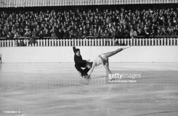 Austrian figure skater Kurt Oppelt and Austrian figure skater Sissy Schwarz performing their routine on the ice during the figure skating pairs event...