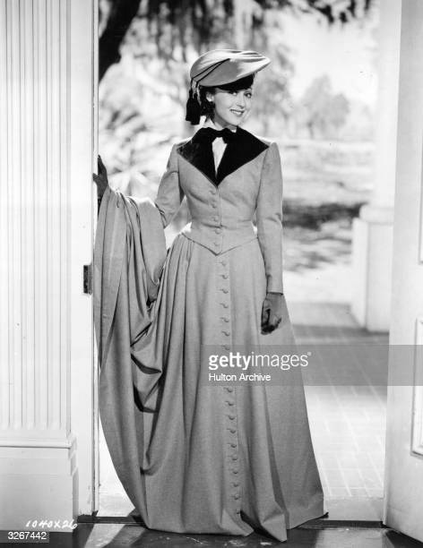 Austrian film actress Luise Rainer dressed in a riding habit designed by Adrian in a scene from 'The Toy Wife'