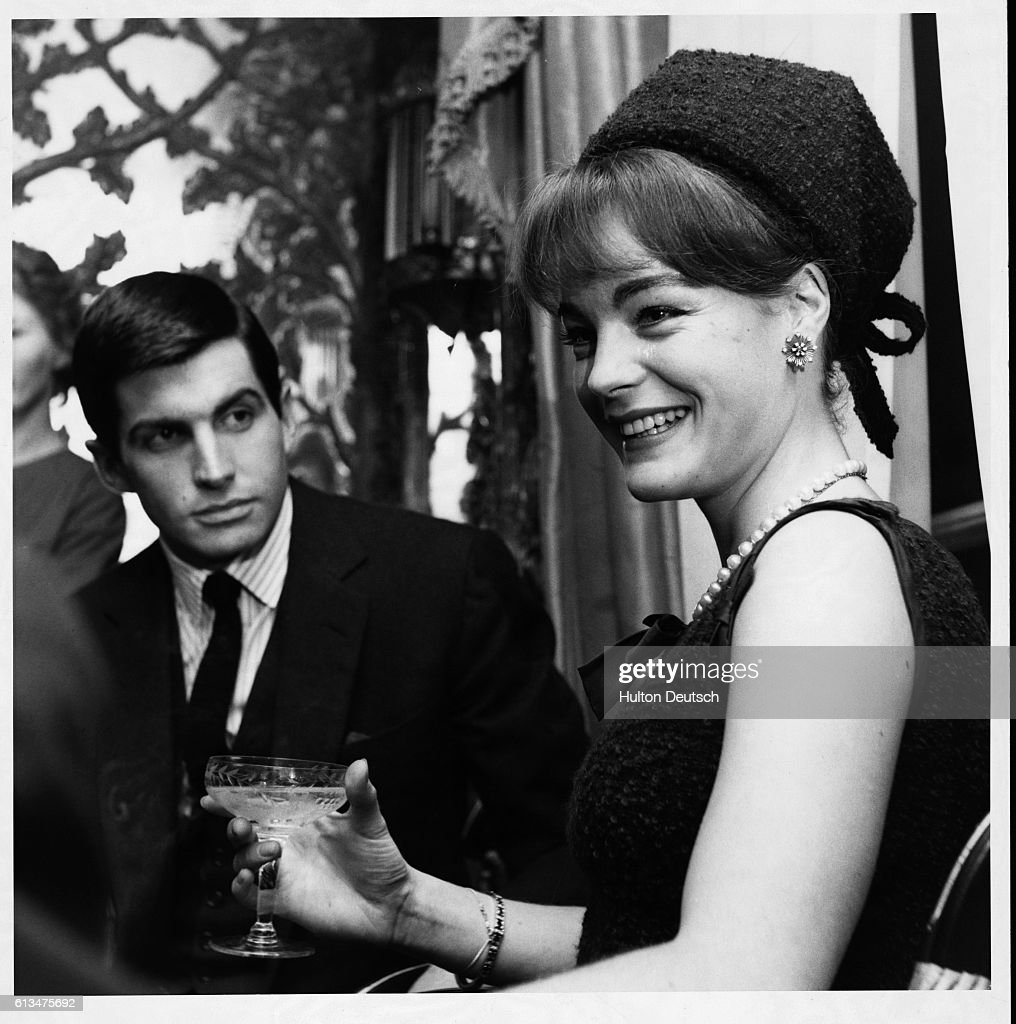 Austrian film actress Romy Schneider with American actor George Hamilton, London, 1962. Schneider and Hamilton co-starred in The Victors released in 1963.
