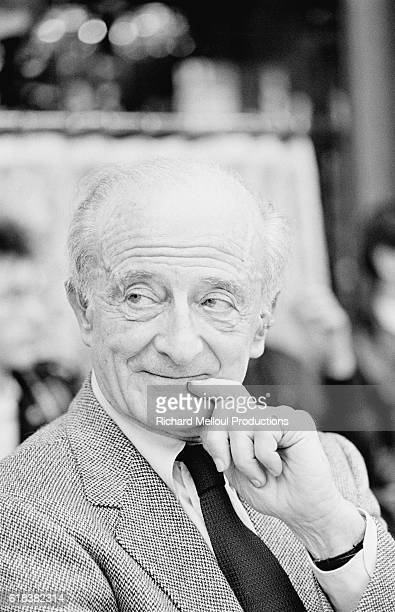 Austrian film director Fred Zinnemann looks thoughtful as he holds his hand to his chin.