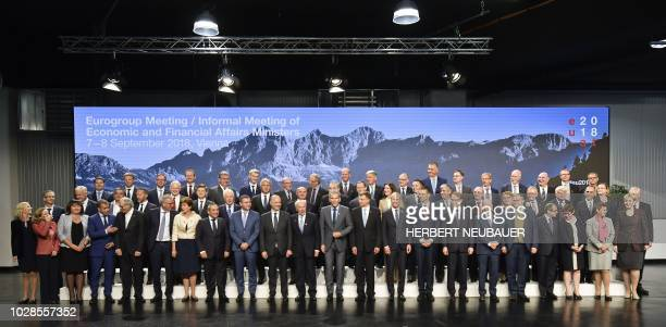 Austrian Finance Minister Hartwig Loeger and other participants pose for a family photo at a Eurogroup meeting Informal meeting of economic and...