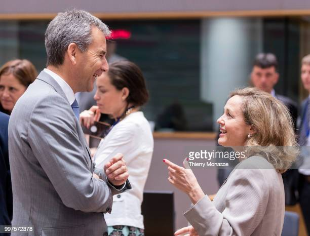 BRUSSELS BELGIUM JULY 13 Austrian Finance Minister President of the Council Hartwig Loeger is talking with the Spanish Minister of Minister of...