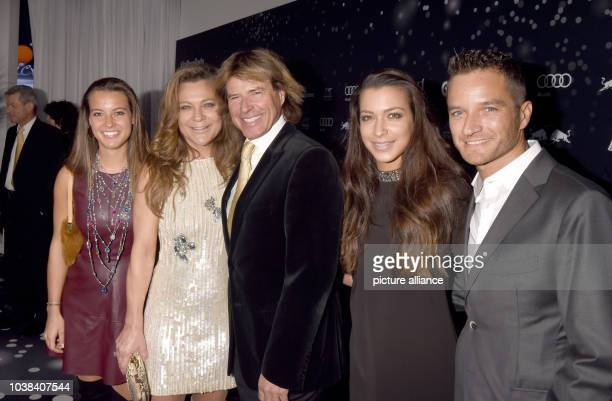 Austrian folk singer Hansi Hinterseer , his wife Romana , their daughters Laura and Jessica and her partner Timo Scheider arrive for the Kitz Race...