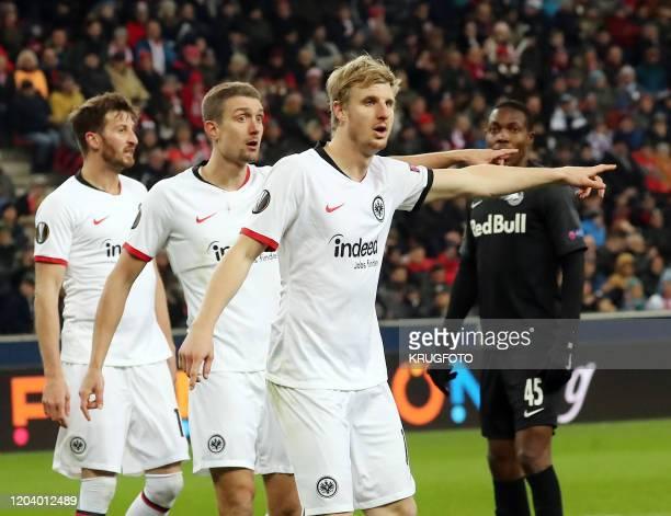 Austrian football midfielder Stefan Ilsanker and Frankfurt's German defender Martin Hinteregger gesture during the UEFA Europa League Last 32 Second...