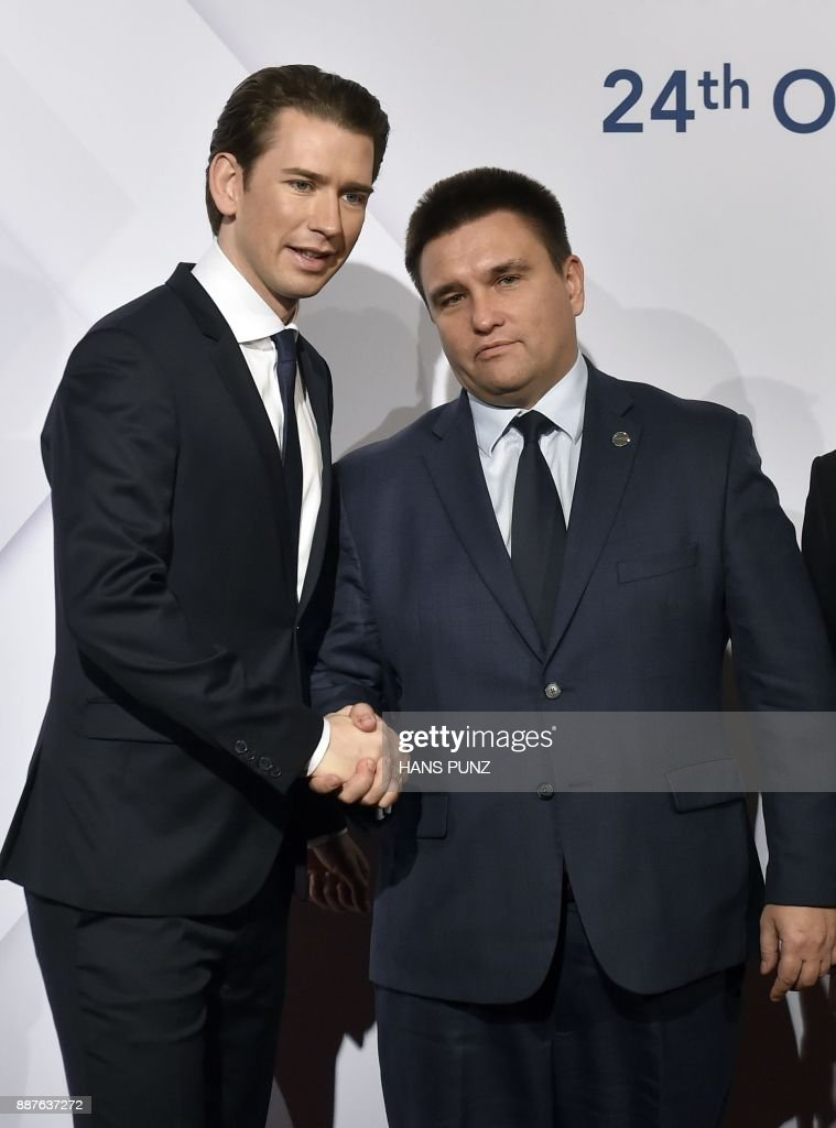 Austrian Foreign Minister and current OSCE Chairman Sebastian Kurz and Ukrainian Minister of Foreign Affairs Pavlo Klimkin greet each other before the start of the 24th OSCE Ministerial Council in Vienna, on December 07, 2017. ?Foreign ministers of the OSCE's 57 member states including US Secretary of State Rex Tillerson and Russian counterpart Sergei Lavrov hold the annual conference, during which the conflict in Ukraine will likely be a major topic. / AFP PHOTO / APA / HANS PUNZ / Austria OUT