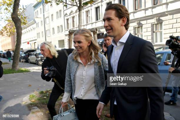 Austrian Foreign Minister and leader of the conservative Austrian People's Party Sebastian Kurz and his girlfriend Susanne Thier arrive to cast his...