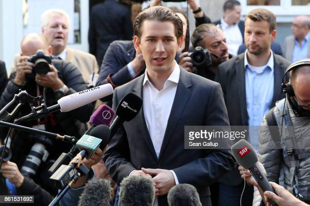 Austrian Foreign Minister and leader of the conservative Austrian People's Party Sebastian Kurz speaks to media as he arrives to cast his ballot in...