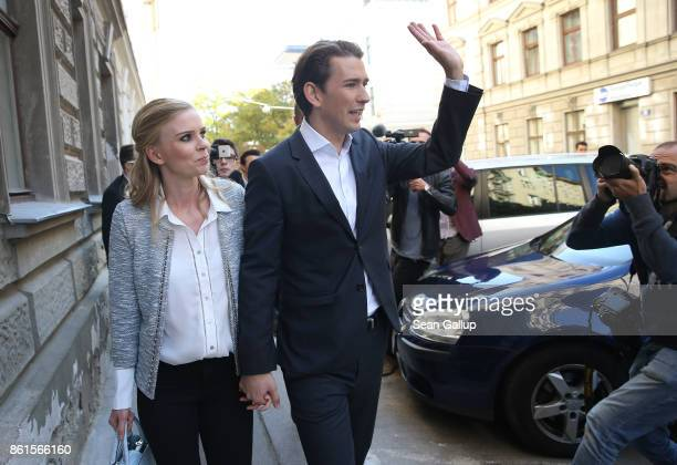 Austrian Foreign Minister and leader of the conservative Austrian Peoples Party Sebastian Kurz and his girlfriend Susanne Thier leave after casting...