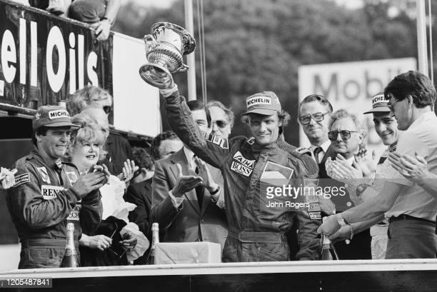 Austrian Formula One driver Niki Lauda of Team Marlboro McLaren International celebrating his victory at the 1984 British Grand Prix at Brands Hatch...