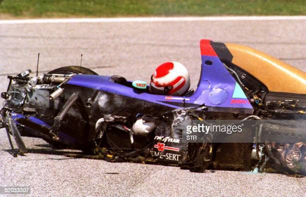Austrian Formula One driver Roland Ratzenberger lies in his car 30 April 1994 just after he crashed during a practice run on the Imola Italy track...