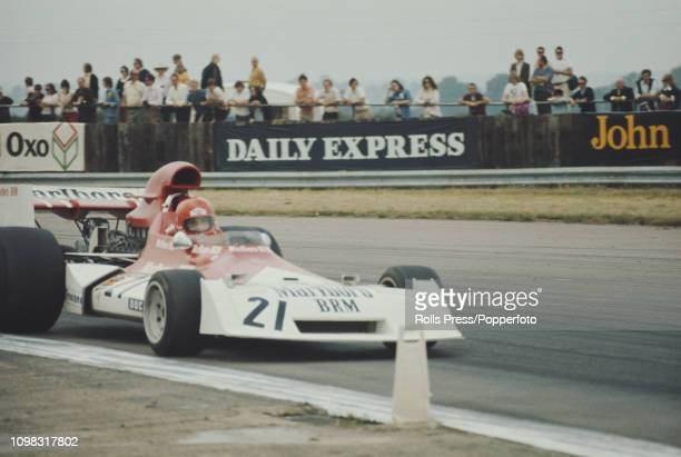 Austrian Formula One racing driver Niki Lauda drives the Marlboro BRM BRM P160E BRM P142 V12 to finish in 12th place in the 1973 British Grand Prix...