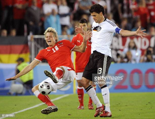 Austrian forward Roman Kienast falls next to German midfielder Michael Ballack during the Euro 2008 Championships Group B football match Austria vs....