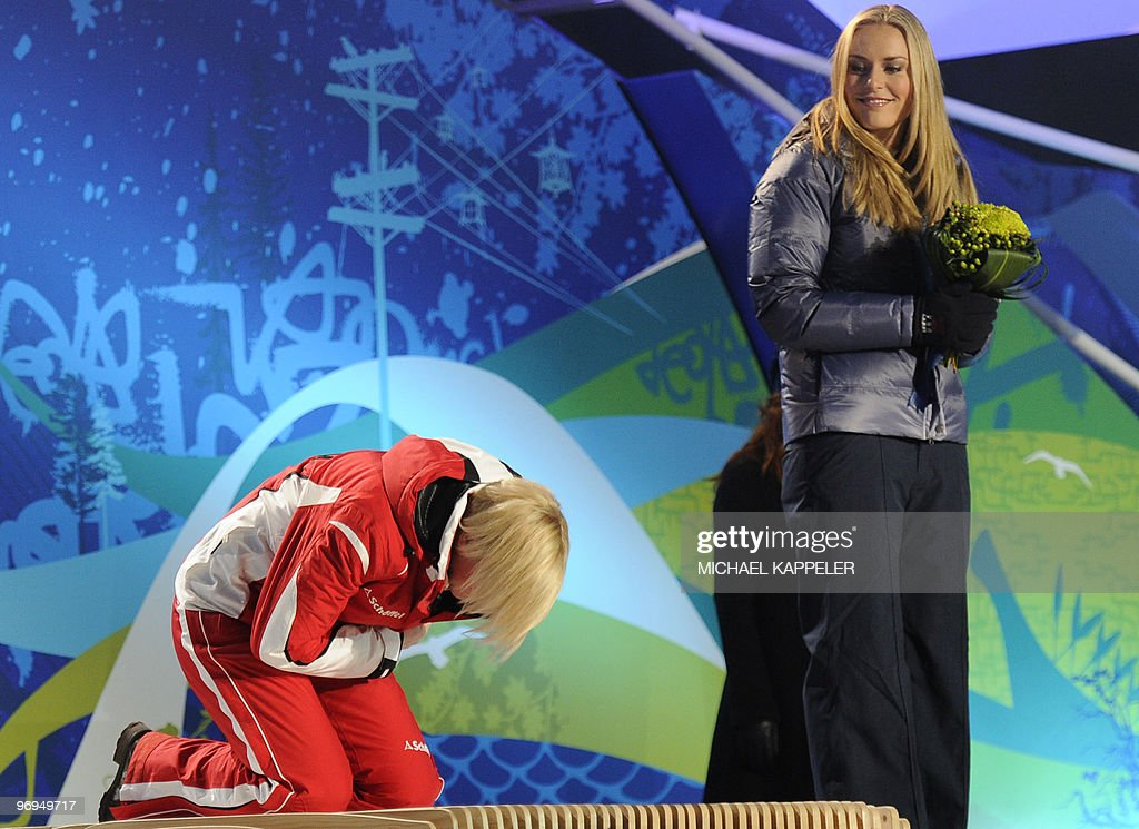 Austrian gold medallist Andrea Fischbacher (L) and US bronze medallist Lindsey Vonn celebrate on the podium during the medal ceremony of the women's alpine skiing Super-G race of the Vancouver Winter Olympics in Whistler on February 20, 2010.
