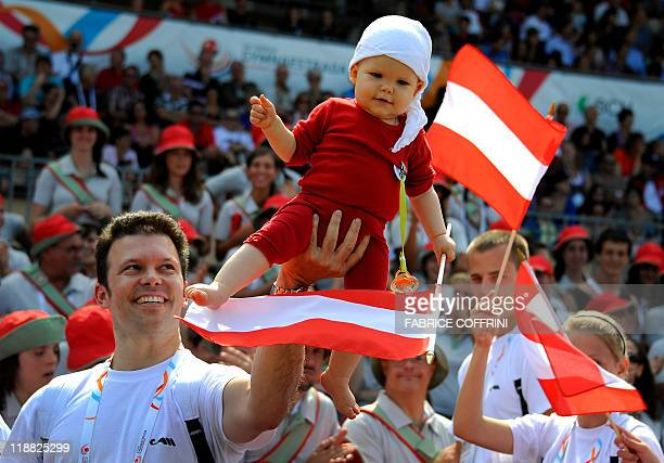 Austrian gymnasts parade in the Olympic Stadium during the opening ceremony at the opening ceremony of World Gymnaestrada 2011 on July 10, 2011 at...
