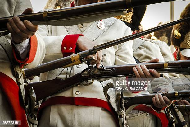 Austrian imperial soldiers loading muzzleloading flintlock rifles Napoleonic wars end of 18th century Historical reenactment