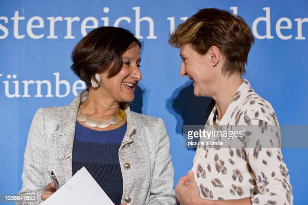 Austrian interior minister Johanna MiklLeitner and Simonetta Sommaruga head of the Swiss justice and police department talk to each other at a press...