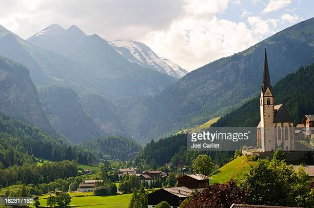 austrian landscape and church in heiligenblut - carinthia stock pictures, royalty-free photos & images