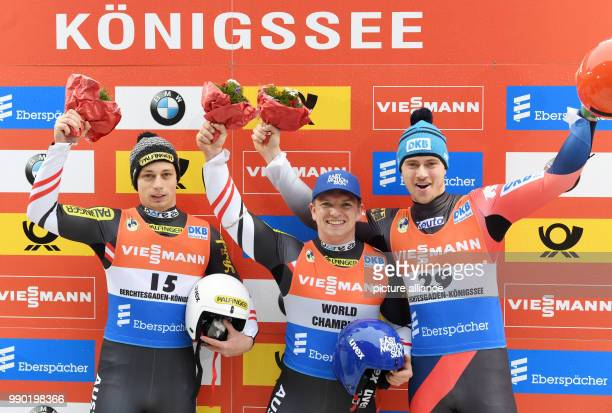 Austrian luger, Armin Frauscher , Austria's Wolfgang Kindl and German luger Johannes Ludwig celebrating during the award ceremony of the Luge World...