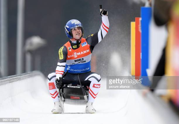 Austrian luger Wolfgang Kindl celebrating at the finish line during the men's singles event of the Luge World Cup 2018 in Schonau am Konigssee in...