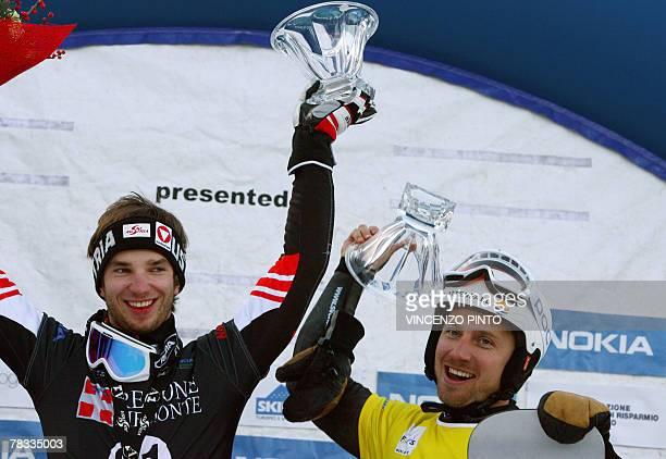 Austrian Manuel Veith and Sweden's Daniel Biveson celebrate on Men's parallel giant slalom snowboard World Cup podium in Limone Piemonte 08 December...