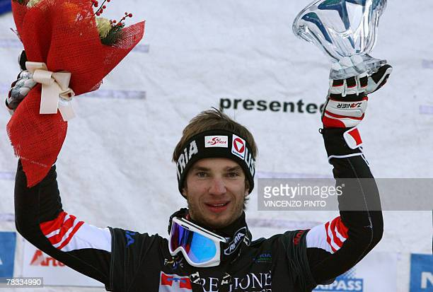 Austrian Manuel Veith celebrates on Men's parallel giant slalom snowboard World Cup podium in Limone Piemonte 08 December 2007 Veith won the race...
