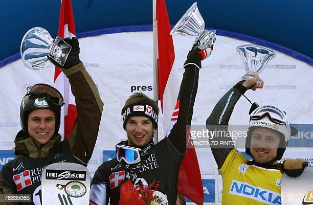 Austrian Manuel Veith Sweden's Daniel Biveson and Canada's Matthew Morison celebrate on Men's parallel giant slalom snowboard World Cup podium in...