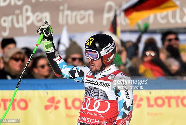 Austrian Marcel Hirscher celebrates after the second men's giant slalom race at the FIS Alpine Skiing World Cup in GarmischPartenkirchen southern...