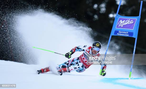 TOPSHOT Austrian Marcel Hirscher races during the first men's giant slalom competition at the FIS Alpine Skiing World Cup in GarmischPartenkirchen...