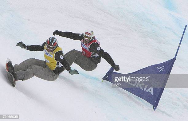 Austrian Mario Fuchs and German David Speiser compete on the Snowboard Cross at the FIS World cup in Leysin 01 February 2008 Austria's Mario Fuchs...
