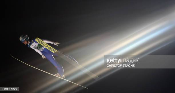 Austrian Michael Hayboeck soars during his qualification jump for the FIS ski jumping World Cup flying hill individual competition in Oberstdorf...