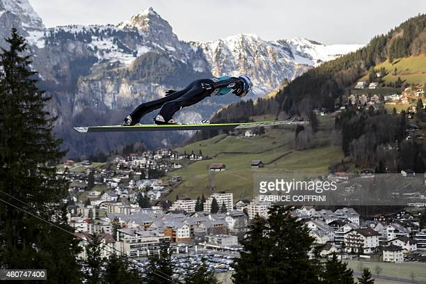 Austrian Michael Hayboeck soars through the air to placed third in the men's FIS Ski Jumping World Cup competition in Engelberg central Switzerland...