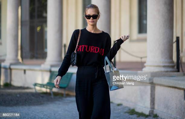 Austrian model Nadine Leopold wearing a black sweater with the print Saturday is seen outside Alberta Ferretti during Milan Fashion Week...