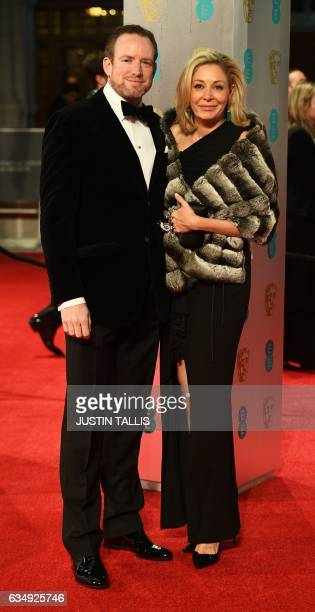 Austrian Nadja Swarovski and her husband Rupert Adams pose upon arrival at the BAFTA British Academy Film Awards at the Royal Albert Hall in London...